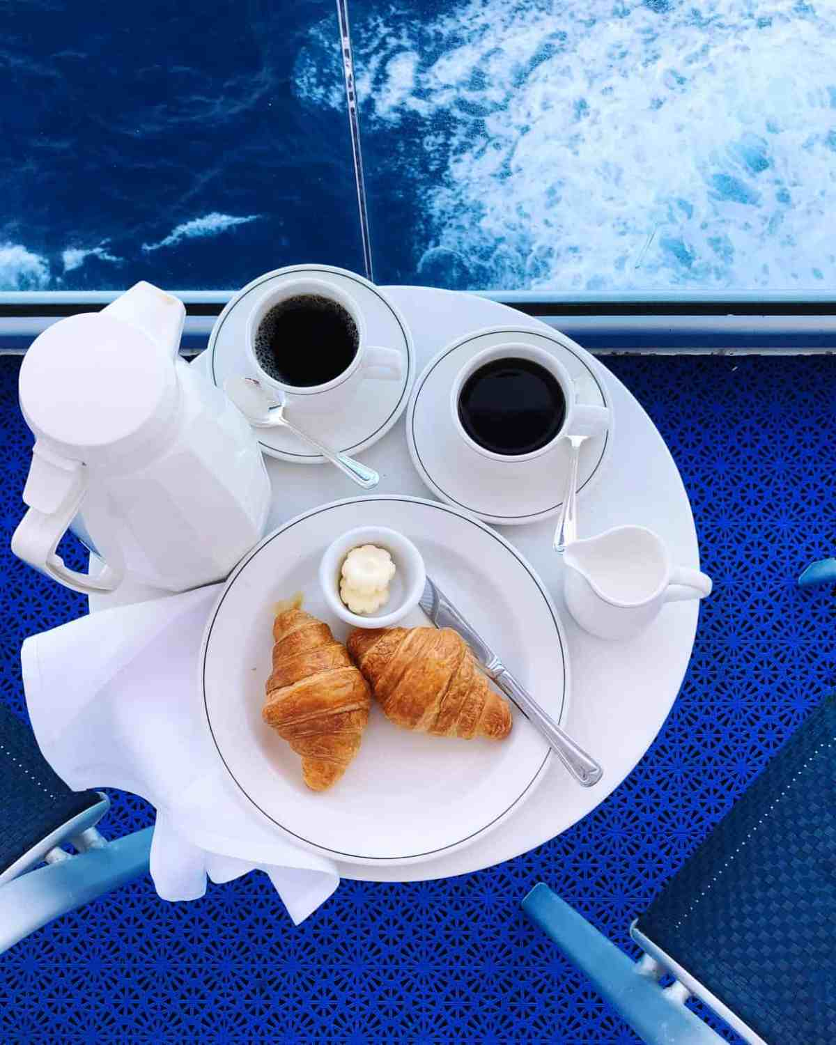 Croissants served on a white plate for breakfast on the balcony on the Ruby Princess.