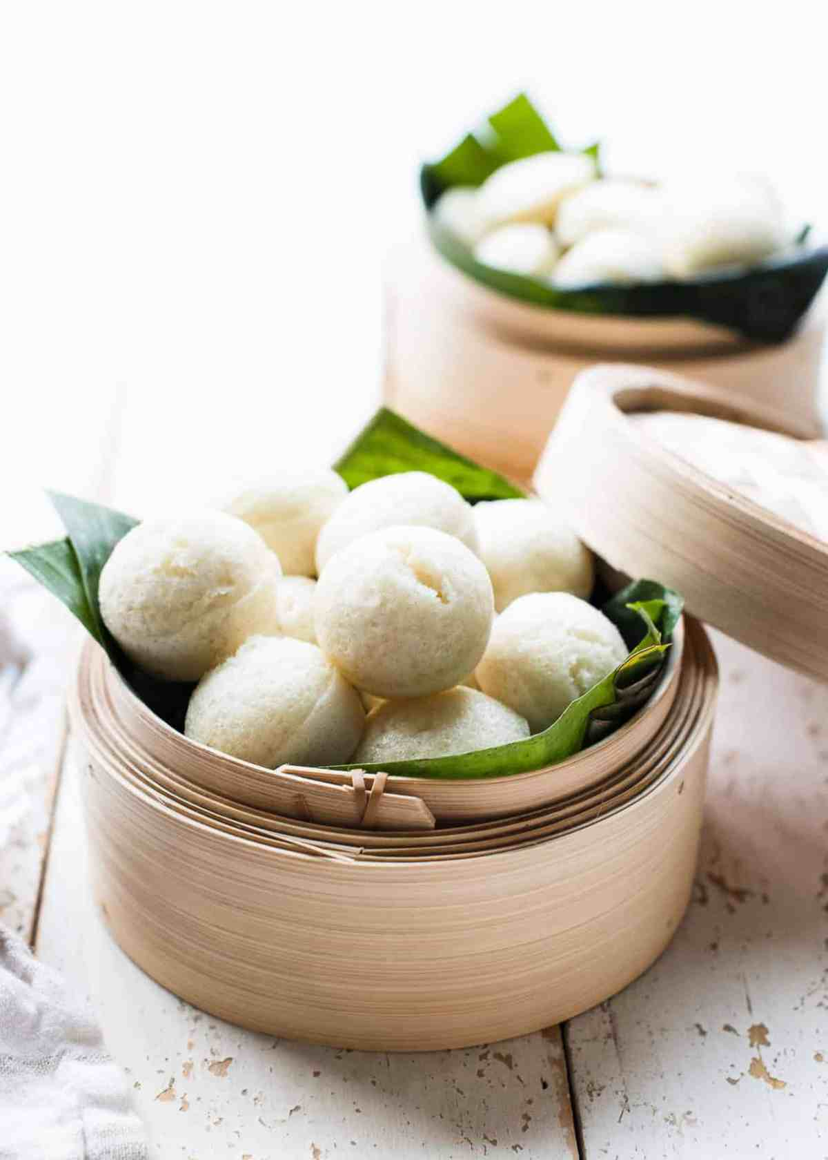 Puto - steamed rice cakes from the Philippines - in a bamboo steamer.