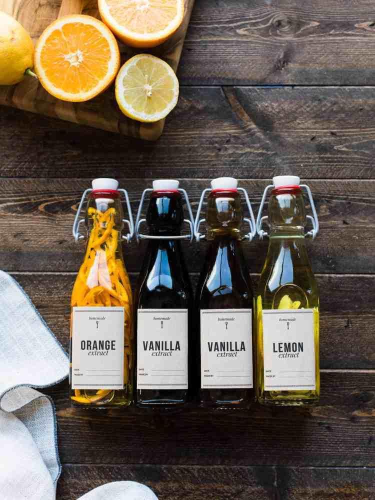 Homemade vanilla, orange and lemon extracts in bottles.