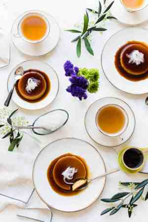 Coconut Leche Flan on white plates on a white table served with tea.