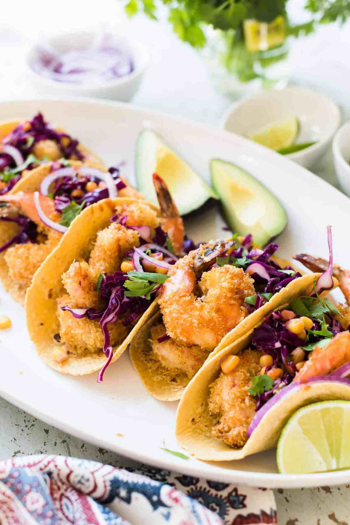 Tacos with oven-fried crispy shrimp, red cabbage and corn