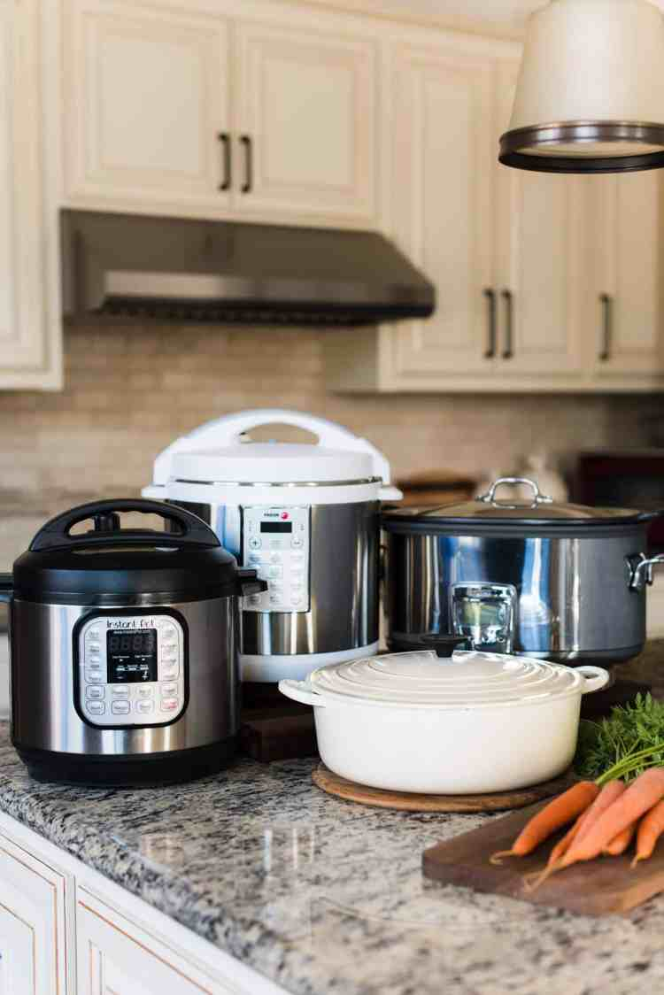 Slow cooker, multicooker, pressure cooker, Dutch oven in kitchen