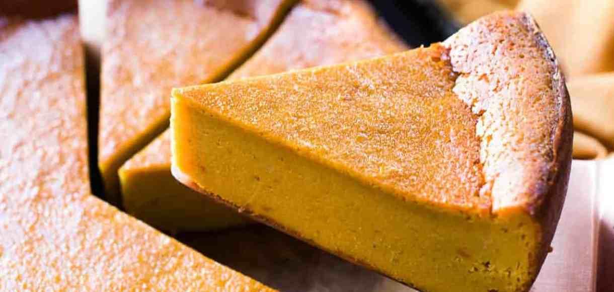 A slice of Sweet Potato Bebinca on a cake knife.
