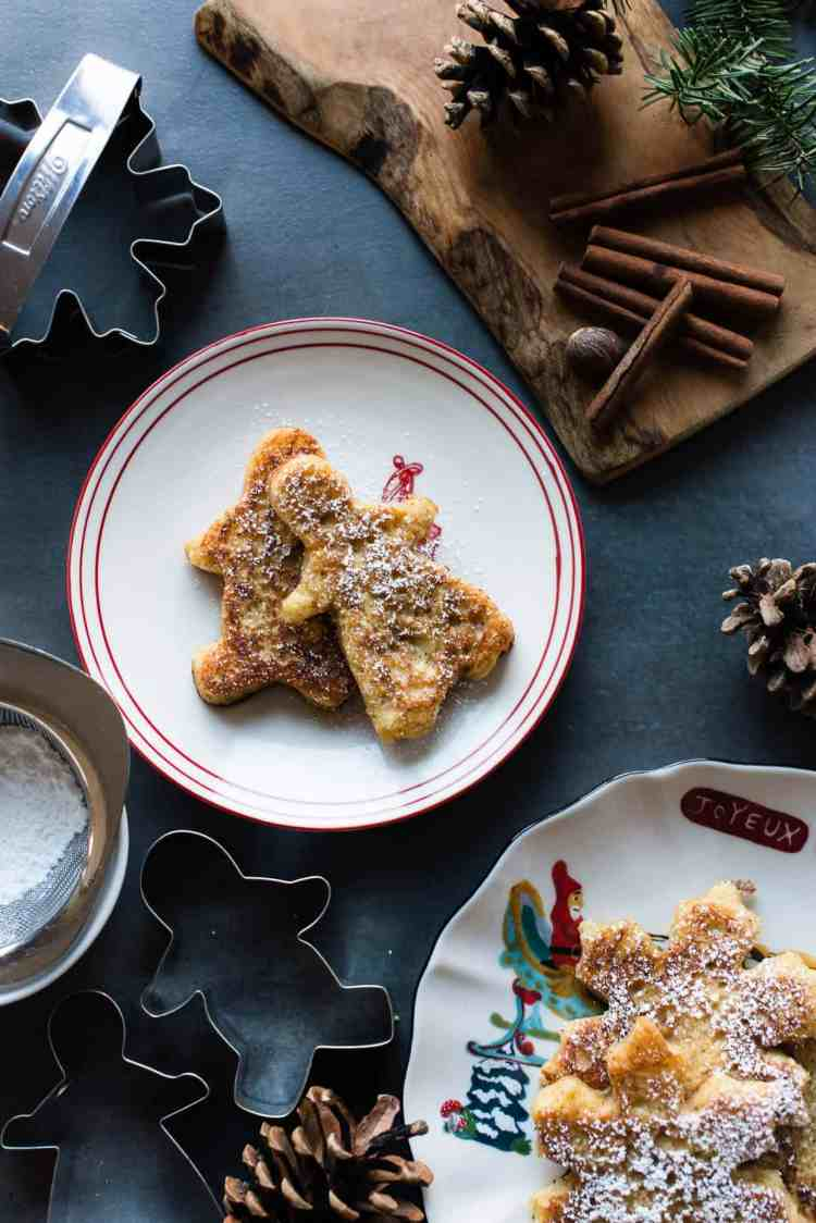 Gingerbread French Toast shaped like gingerbread men on a holiday plate.