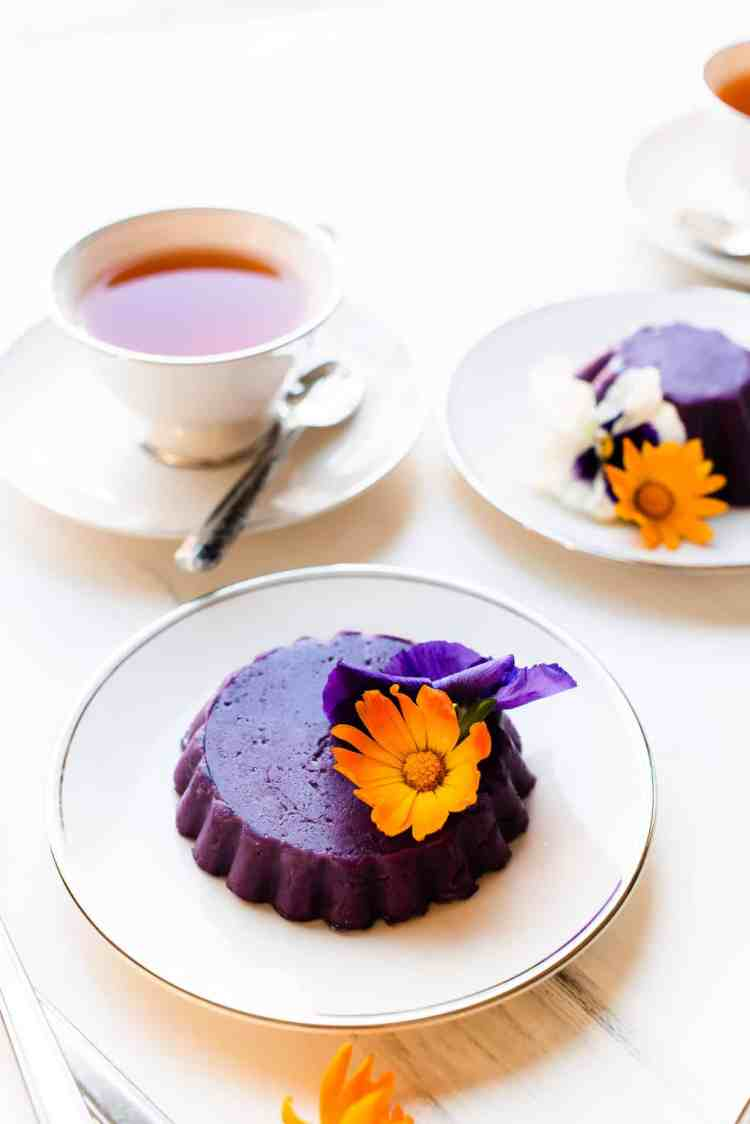 Ube Halaya molded into a pretty cake and garnished with edible flowers.