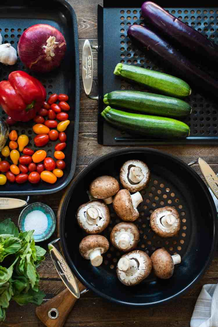Summer vegetables on All-Clad Outdoor Nonstick Grill Pans for a grilled vegetable pizza recipe.