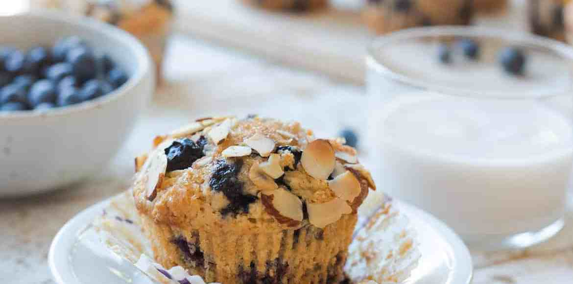 Blueberry Almond Butter Muffins on a white plate.