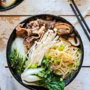 Beef noodle soup in a bowl: mushroom and short rib noodle soup with bok choy.