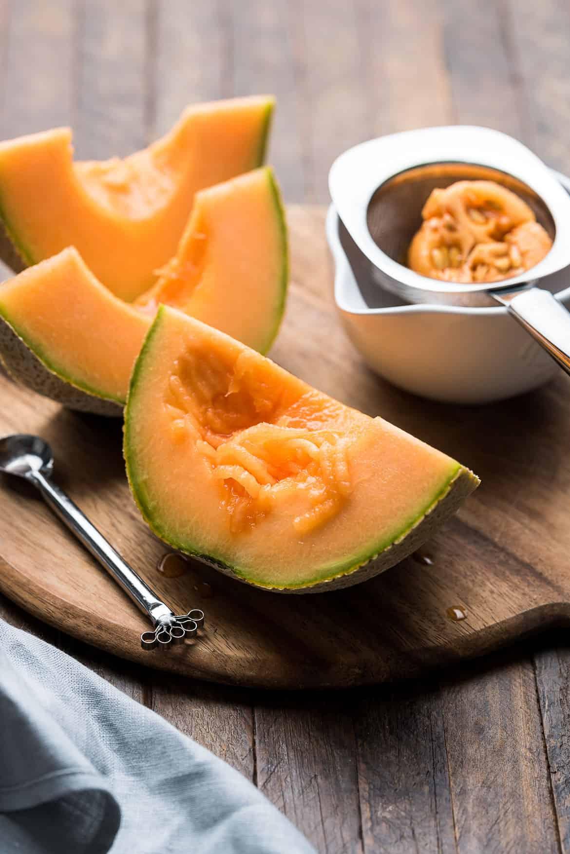 Shredding cantaloupe for Cantaloupe Juice