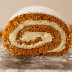 Pumpkin Roll Cake With Orange Cream Cheese.