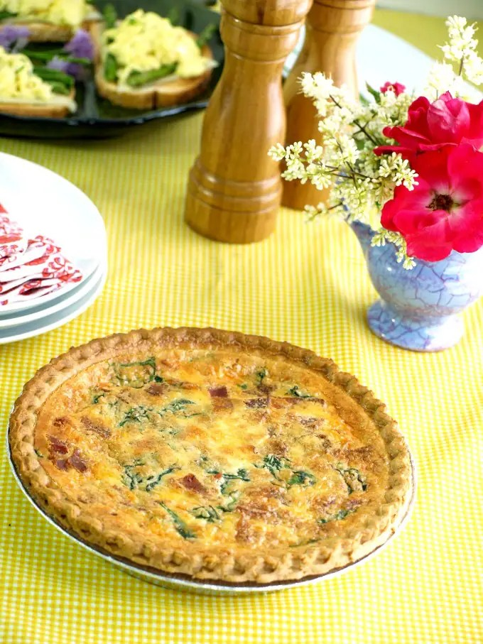 Spinach and Bacon Quiche is easy to prepare at home and since many can be made at once, can easily feed a crowd.