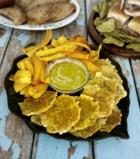 Homemade Green Plantain Chips with Mojo Vinaigrette are so easy to make and are reminiscent of the style chips served in the Cuban cafes. | KitchenDreaming.com |