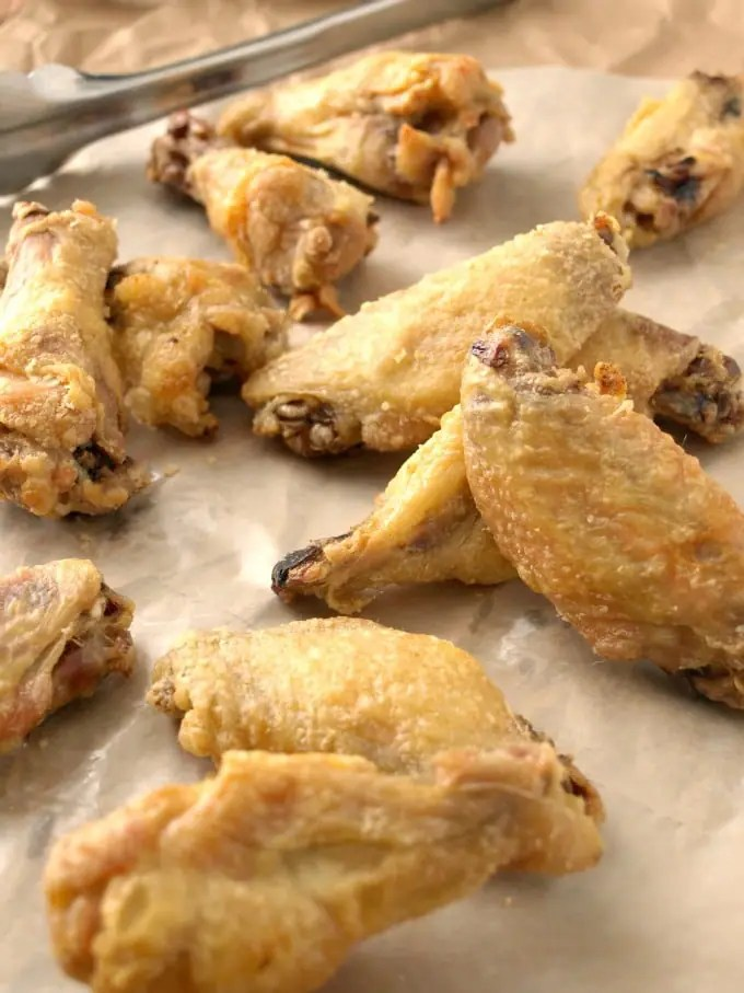 Bring the deliciousness of the wing shop home to your oven with Crispy Baked Chicken Wings that have a crisp exterior that mimics being fried.