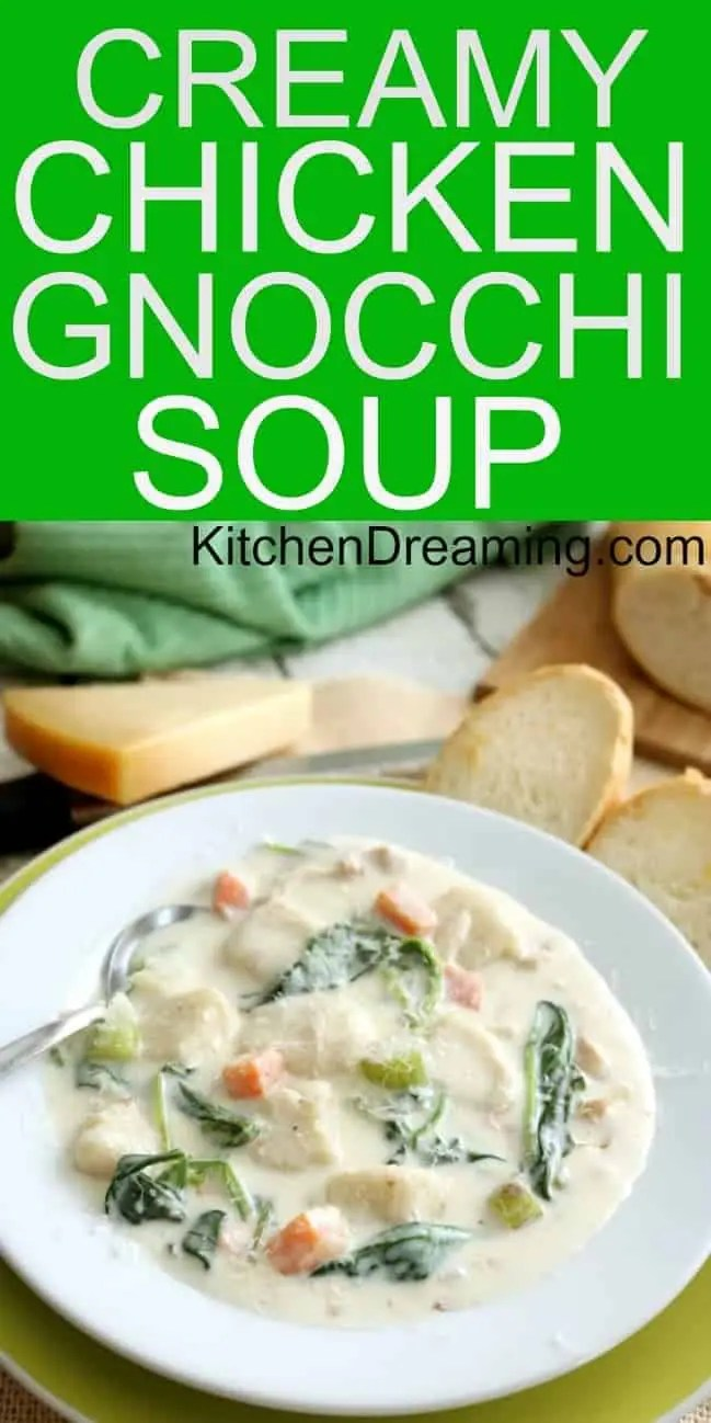 a pinnable image of chicken gnocchi soup in a bowl with bread and parmesan cheese in the background.