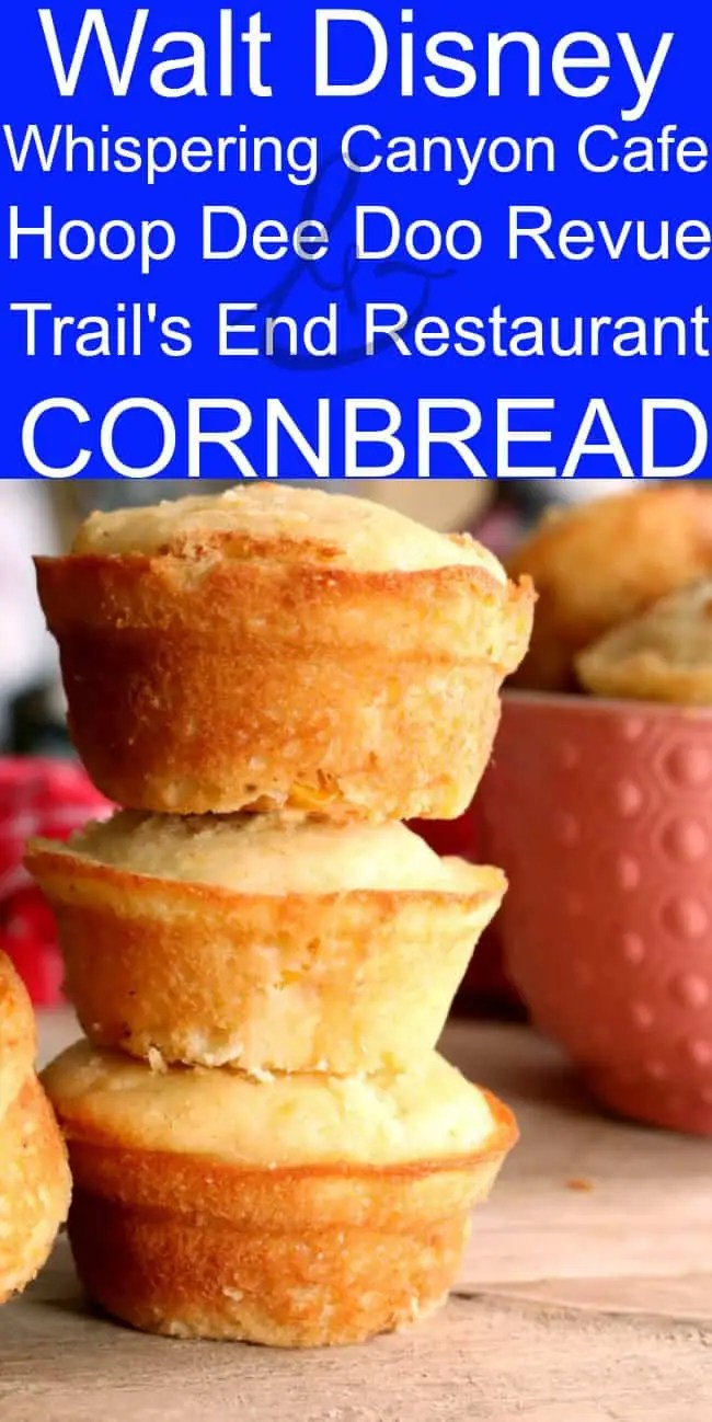 Cornbread stacked 3 tall on top of one another with a pink bowl and a red checkered towel in the background.