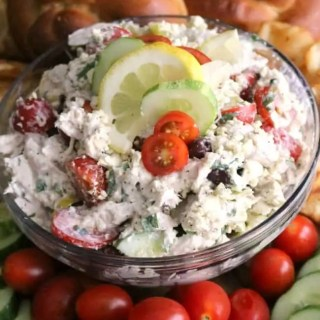 This Easy Greek Chicken Salad is loaded with fresh Mediterranean ingredients like fresh lemon juice, olives, tomatoes, cucumber, Greek yogurt, and feta cheese. This make-ahead dish is perfect for summer entertaining.