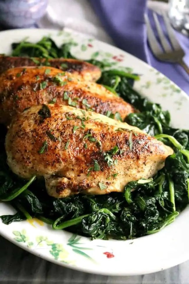 Chicken Florentine is an Italian-style dish where pan seared chicken breasts are served on a bed of freshly wilted spinach and drizzled with a creamy pan gravy. Yes, it's as good as it sounds!