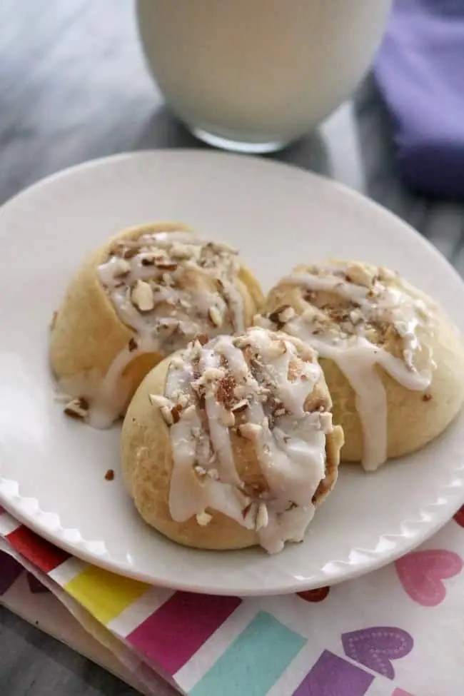 These Easy Raspberry Almond Sweet Rolls are filled with a cream cheese and raspberry filling. These little buns are a favorite brunch pastry and use up some leftover ingredients in the refrigerator.