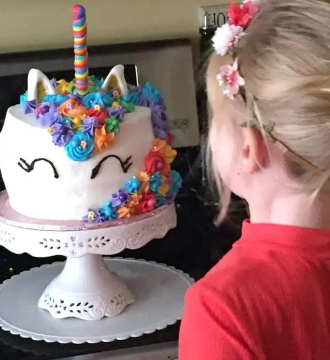 my daughter and her unicorn cake