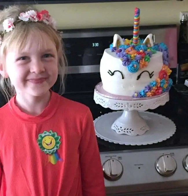my daughter and her mystical unicorn cake.