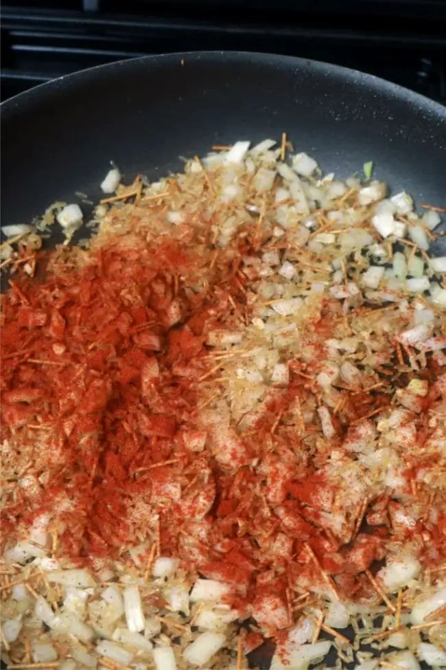 Paprika sprinkled over the top of the rice pilaf.