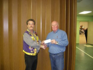 Presentation - Our Lion Chief making a presentation to the Preston Scout House Band