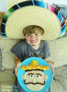 Here is my 6 year old with his fun Cinco de Mayo Mexican Dinner!