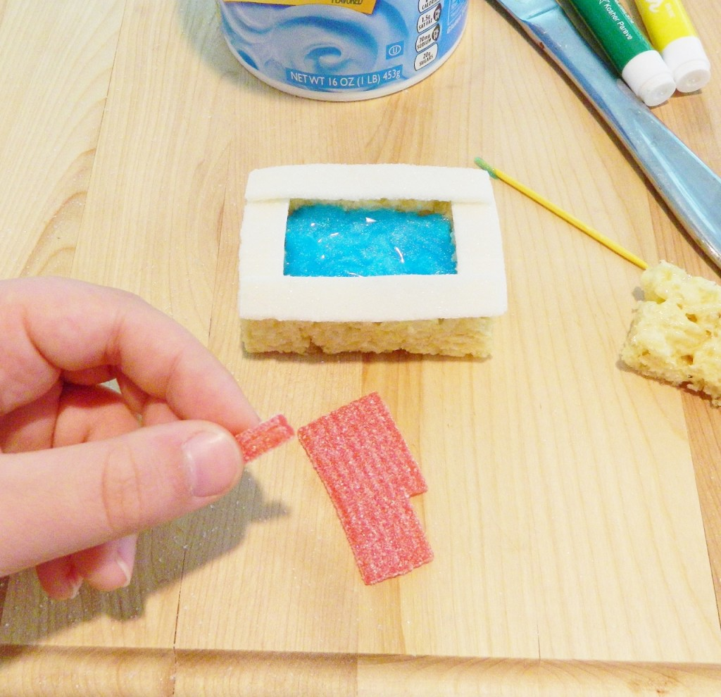 Cut a small piece from a red Rips candy strip & then another tiny piece to add on top to look like a pool float