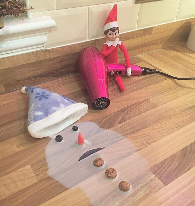 Elf Melting Frosty the Snowman