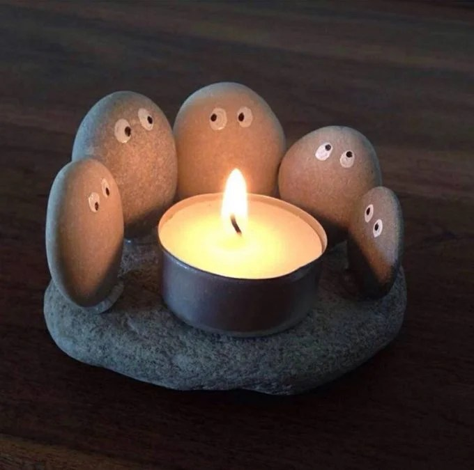 Rock people sitting around a Campfire Candle...so cute!
