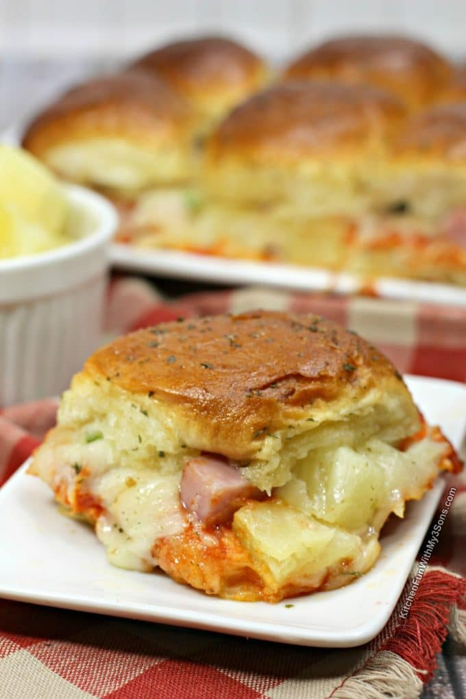 This Hawaiian pizza sliders recipe is one of my favorite easy dinners with chunks of ham and pineapple on sweet rolls.