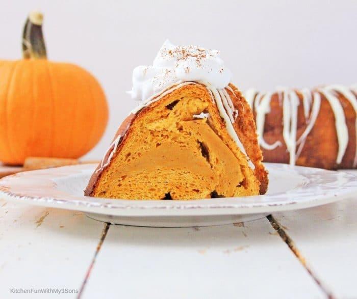 Sliced angel food cake with pumpkin on a white plate