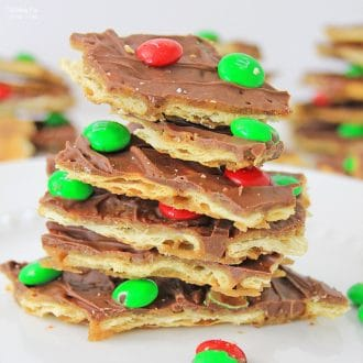 Christmas Crack Recipe is the easiest holiday recipe with buttery sweet toffee like texture and bursts of chocolate and M&M's.