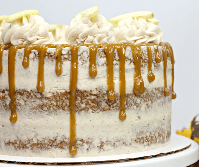 Up close picture of a layered apple spice cake on cake stand