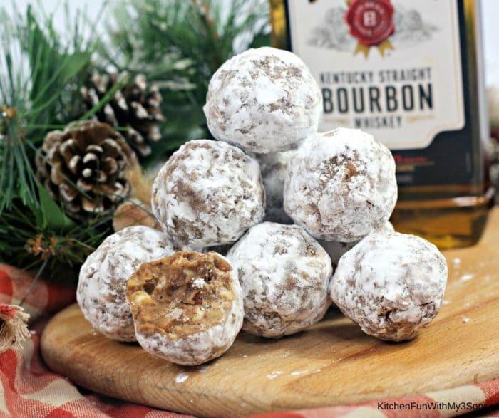 Bourbon balls stacked on a wooden platter