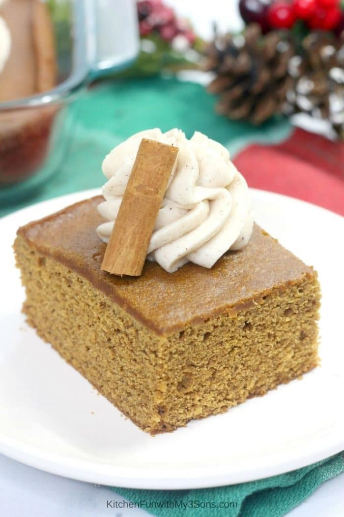 Old fashioned gingerbread cake on a white plate with cinnamon frosting