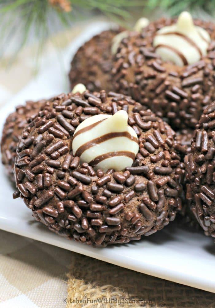 Close up chocolate thumbprint cookie with Hersheys hugs