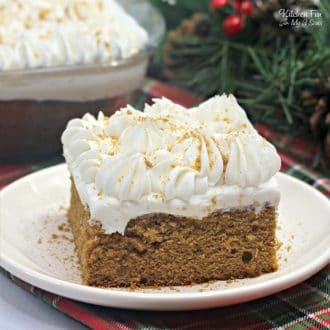 Gingerbread Poke Cake is a tasty spice cake recipe with molasses and filled with sweetened condensed milk. All topped off with whipped cream and gingerbread cookies!