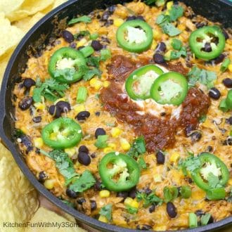 Cast iron skillet of enchilada dip with rotisserie chicken