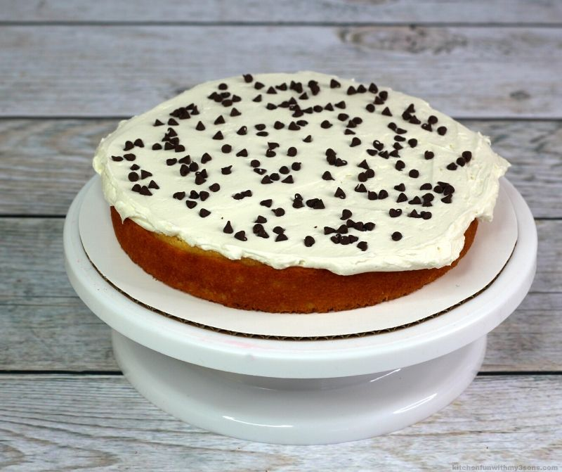 cake layer with frosting and chocolate chips