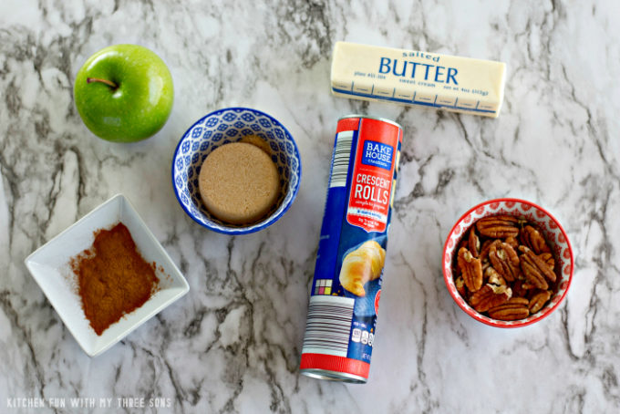 ingredients to make Apple Pie Bites on a marble counter