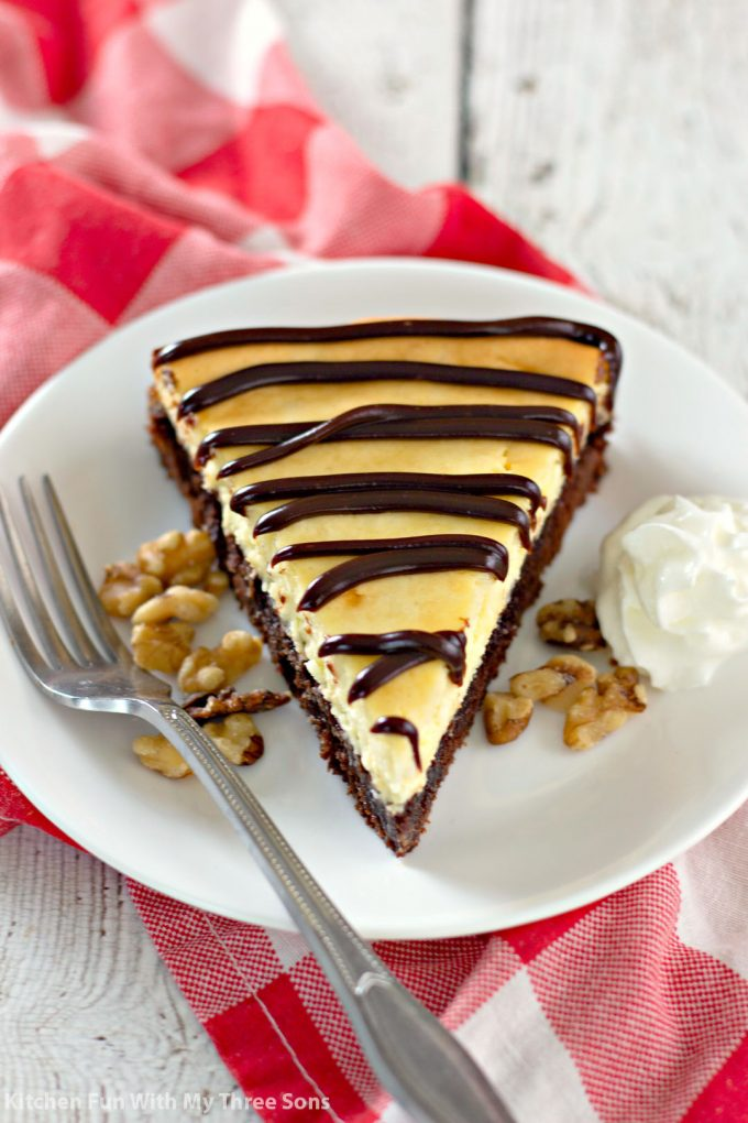 a slice of Brownie Bottom Cheesecake on a white plate
