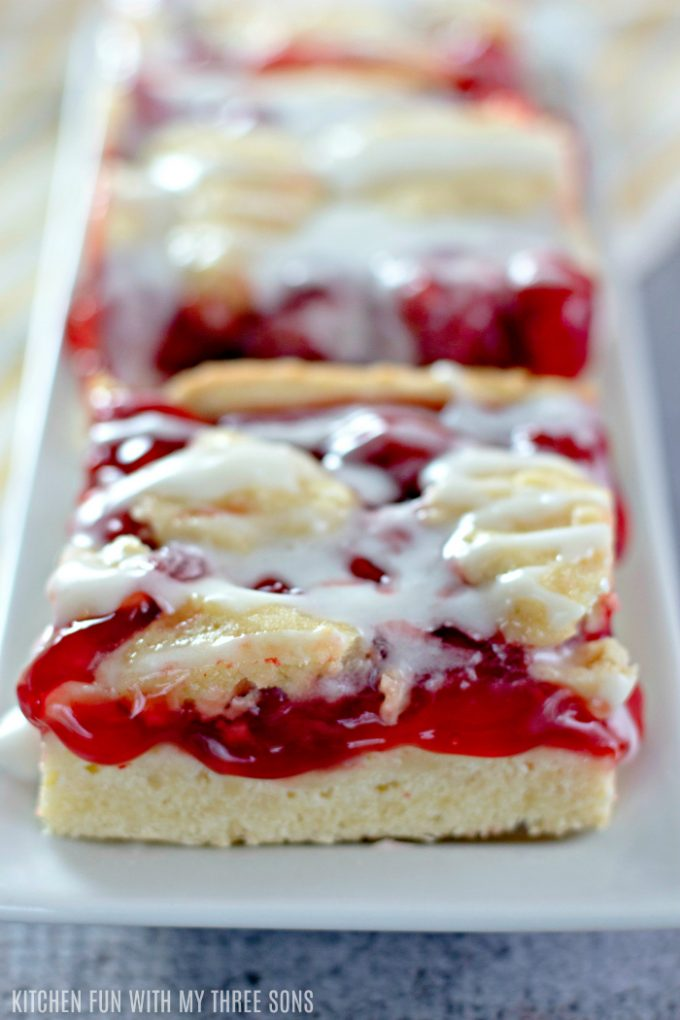 cherry bars on a white rectangle dish
