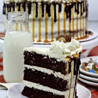 twix cake on a white plate