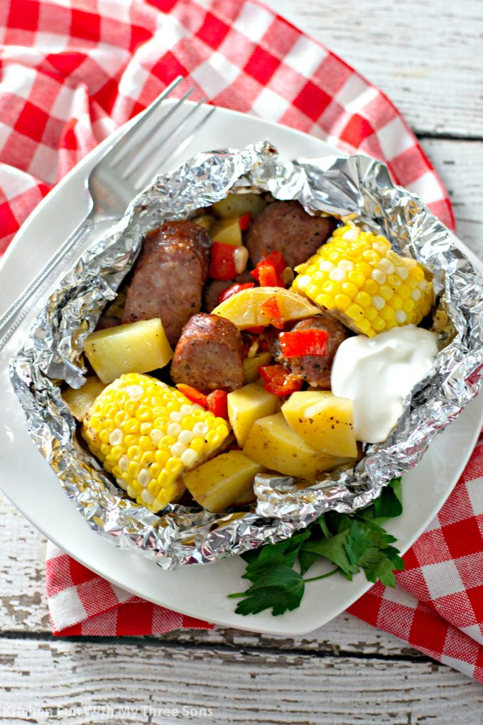 Garlic Kielbasa Grilled Foil Packets with a red and white checkered napkin