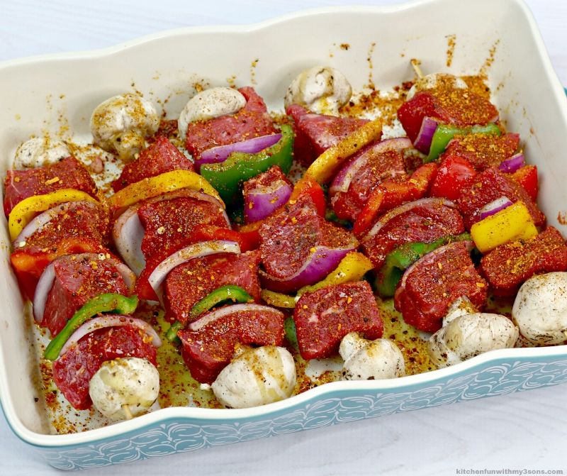 raw kabobs in a casserole dish