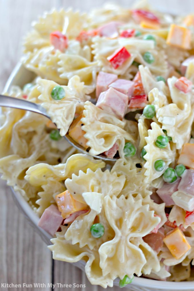 scooping out a serving of Bowtie Pasta Salad Recipe
