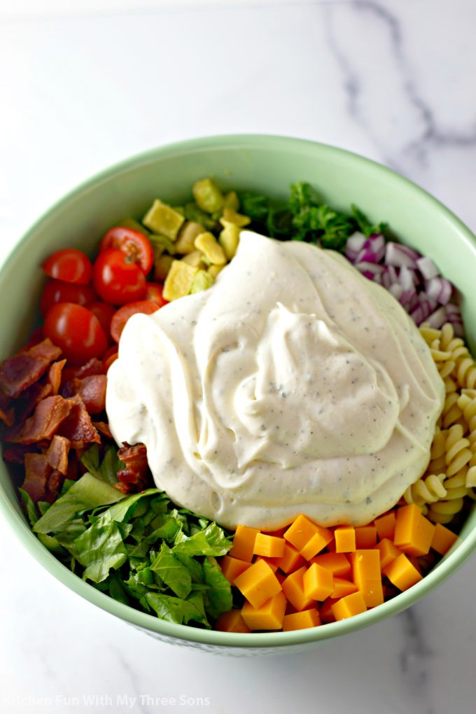 salad dressing added to the bowl
