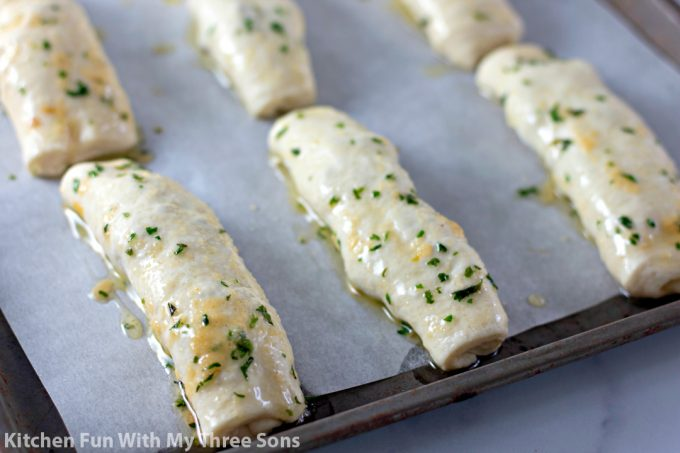 breadsticks basted in herb butter