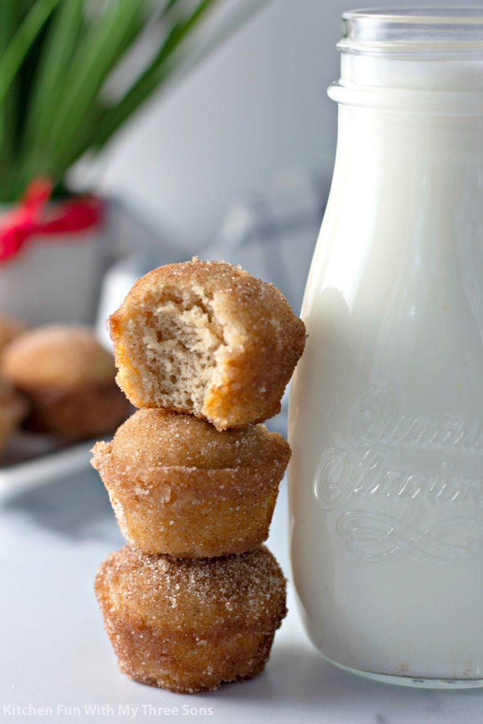 Cinnamon Sugar Donut Muffins stacked next to milk
